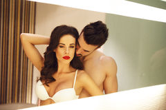 Sexy couple posing in mirror Stock Image