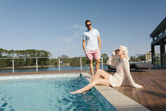 Couple poolside Stock Photo