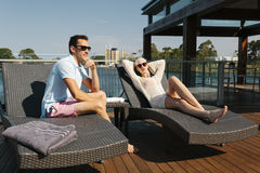 Couple on sunbed Royalty Free Stock Images