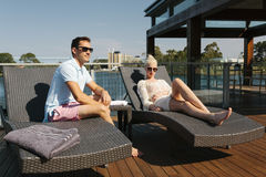 Couple on sunbed Stock Images