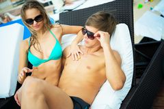 Sexy couple on a resort Stock Images