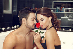 Sexy couple smell rose in jacuzzi Stock Image