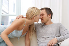 Sexy couple on Sofa at Home. Stock Photo