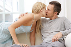 Sexy couple on Sofa at Home. Royalty Free Stock Photos