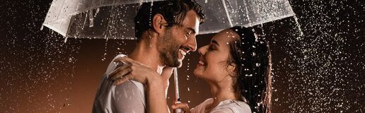 sexy couple in wet shirts with