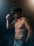 Sexy cowboy with smoky background Stock Image