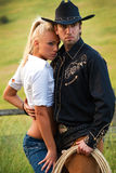 Sexy cowboy and woman Royalty Free Stock Images