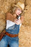 Sexy Cowgirl. Sexy blond cowgirl pointing gun Stock Photography