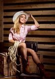 A sexy cowgirl posing in a hat Stock Images