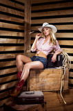 A sexy cowgirl posing in a hat Stock Photo