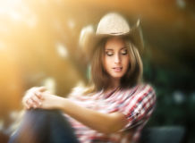 Sexy cowgirl in sun light Stock Images