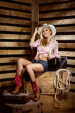 A sexy cowgirl woman posing in a barn Royalty Free Stock Photos