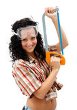 Sexy craftswoman with a saw Royalty Free Stock Images