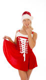 Sexy curious blonde in santa clothes. Portrait of attractive curious girl dressed as Santa Stock Photo