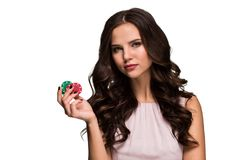 Curly hair brunette posing with chips in her hands, poker concept isolation on white background. Casino, poker, Roulette Blackjack Spin. Big win emotions royalty free stock photos