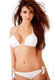 Sexy curvy brunette in a white bikini Stock Photography