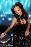 Sexy curvy DJ mixing music Stock Images