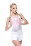 Sexy cute blond girl holding pink balloon and smiling. Royalty Free Stock Image