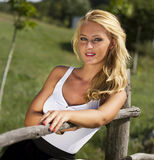 cute blonde woman in nature Royalty Free Stock Image