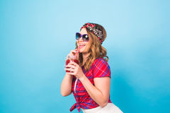 Sexy cute girl in sunglasses, posing in studio, drinking fruit juice or cocktail Stock Photography