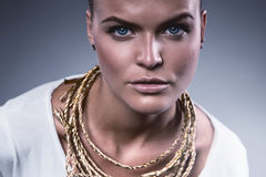Sexy cute woman with gold rope Royalty Free Stock Images