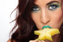 Sexy Dame Eating Star Fruit royalty-vrije stock afbeelding