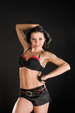 Sexy dancer on black background. Sexy go-go dancer performing on black background Royalty Free Stock Image
