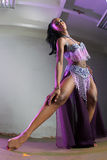 Black woman belly dancing in purple costume Stock Photography