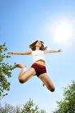 Sexy dancer jumping. With blue sky Royalty Free Stock Images