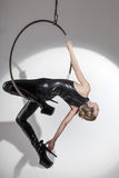 Sexy dancer in latex catsuit on aerial hoop Royalty Free Stock Photography