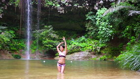 Sexy dancer on waterfall in borneo rainforest stock video footage
