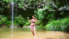 Sexy dancer on waterfall in borneo rainforest stock footage