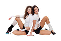 Sexy dancers. Two sexy dancers posing for photo sitting on the floor Stock Photos