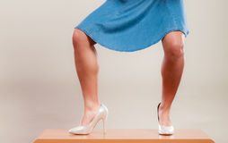 Sexy dancing woman legs in high heels and skirt. Royalty Free Stock Photos