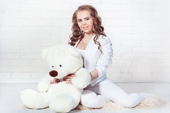 dark blonde girl plush teddy bear royalty free stock images
