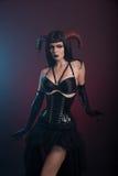Sexy demonmeisje met hoornen Royalty-vrije Stock Fotografie