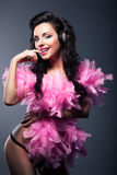 Sexy Desirable Woman in Pink Feathers Dancing - Nightlife. Tempting Woman in Pink Feathers Dancing - Nightlife Royalty Free Stock Photo