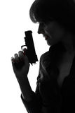 Sexy detective  woman holding aiming  gun silhouette Royalty Free Stock Photo