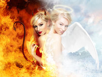 Devil vs gorgeous angel. Young blond woman as half devil half angel stock image