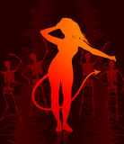 Sexy devil woman on dark background with skeletons Royalty Free Stock Photography