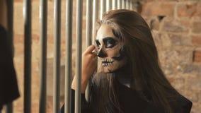 Sexy devilish female vampire flirting with other vampires near lattice. In full HD stock video