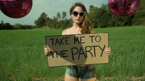 Sexy disco woman dancing and posing outdoors and hitchhiking stock video footage
