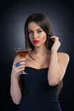 Sexy diva. Holding a cocktail glass Stock Photography