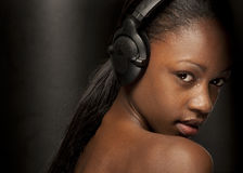 Sexy dj. Girl listening to music looking happy and sexy Royalty Free Stock Photo