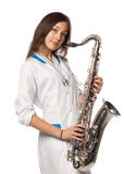 Sexy doctor with saxophone Royalty Free Stock Photos