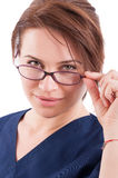 Sexy doctor woman looking over glasses Stock Images