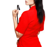 Dominant woman in red suit and whip isolated. Dominant woman in red suit and whip, bdsm, isolated on white royalty free stock photo