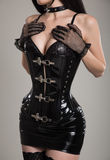 Sexy dominatrix woman in black fetish corset Royalty Free Stock Photography