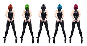 Sexy dominatrixes with various color of hair isolated. Sexy dominatrixes in latex catsuit and boots with various color of hair, isolated on white Royalty Free Stock Images