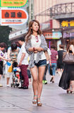 dressed young woman in commercial area, Shanghai, China stock images